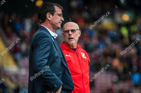 Swindon Town first team coach Tommy Wright speaks with Bradford City Manager Gary Bowyer before the EFL Sky Bet League 2 match between Bradford City and Swindon Town at the Utilita Energy Stadium, Bradford
