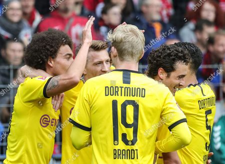 Dortmund's Axel Witsel (L) celebrates with teammates his opening goal during the German Bundesliga soccer match between SC Freiburg and Borussia Dortmund in Freiburg, Germany, 05 October 2019.