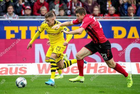 Freiburg's Dominique Heintz (R) in action against Dortmund's Thorgan Hazard during the German Bundesliga soccer match between SC Freiburg and Borussia Dortmund in Freiburg, Germany, 05 October 2019.