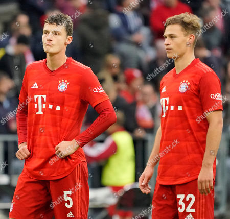 Bayern's Benjamin Pavard (L) and Bayern's Joshua Kimmich (R) react after losing the German Bundesliga soccer match between FC Bayern Munich and TSG 1899 Hoffenheim in Munich, Germany, 05 October 2019.