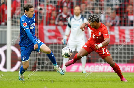 Stock Image of Bayern's Serge Gnabry (R) in action against Hoffenheim's Sebastian Rudy (L) during the German Bundesliga soccer match between FC Bayern Munich and TSG 1899 Hoffenheim in Munich, Germany, 05 October 2019.