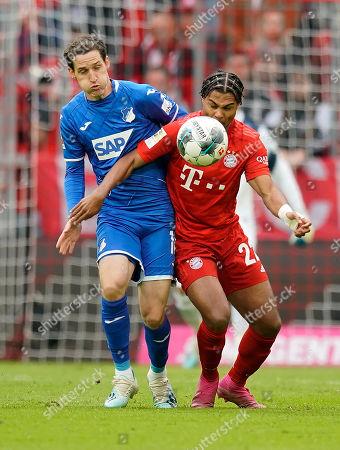 Bayern's Serge Gnabry (R) in action against Hoffenheim's Sebastian Rudy (L) during the German Bundesliga soccer match between FC Bayern Munich and TSG 1899 Hoffenheim in Munich, Germany, 05 October 2019.