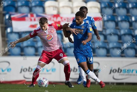 Jason Cowley of Stevenage holds off Brandon Comley of Colchester United during Colchester United vs Stevenage, Sky Bet EFL League 2 Football at the JobServe Community Stadium on 5th October 2019