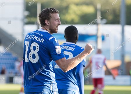 Tom Eastman of Colchester United celebrates Frank Nouble of Colchester United penalty conversion during Colchester United vs Stevenage, Sky Bet EFL League 2 Football at the JobServe Community Stadium on 5th October 2019