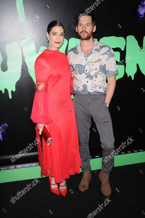Lizzy Caplan (L) and Tom Riley attend the Huluween Celebration held at Huluween HQ in New York City.