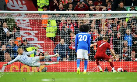 James Milner (R) of Liverpool sends Leicester goalkeeper Kasper Schmeichel the wrong way and scores the winning goal from the spot during the English Premier League match between Liverpool FC and Leicester City at Anfield, Liverpool, Britain, 05 October 2019. Liverpool won 2-1.