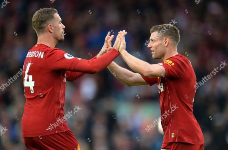 Liverpool captain Jordan Henderson (L) and teammate James Milner celebrate at the final of the English Premier League match between Liverpool FC and Leicester City at Anfield, Liverpool, Britain, 05 October 2019. Liverpool won 2-1.