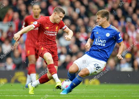 James Milner (L) of Liverpool in action against Dennis Praet of Leicester during the English Premier League match between Liverpool FC and Leicester City at Anfield, Liverpool, Britain, 05 October 2019. Liverpool won 2-1.