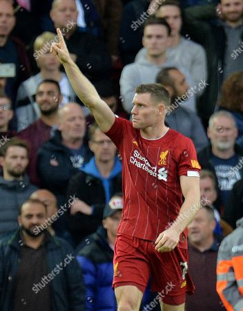 Liverpool's James Milner celebrates scoring the winning goal during the English Premier League match between Liverpool FC and Leicester City at Anfield, Liverpool, Britain, 05 October 2019.