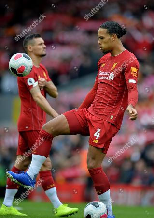 Liverpool's Virgil van Dijk (R) and Liverpool's Dejan Lovren (L) in action during the English Premier League match between Liverpool FC and Leicester City at Anfield, Liverpool, Britain, 05 October 2019.
