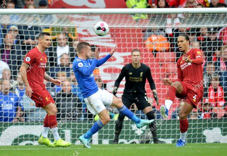 Dejan Lovren (L) and Virgil van Dijk (R) of Liverpool in action against Jamie Vardy of Leicester during the English Premier League match between Liverpool FC and Leicester City at Anfield, Liverpool, Britain, 05 October 2019.