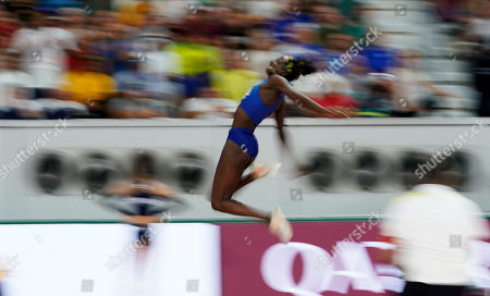Tori Bowie, of the United States, competes in the women's long jump qualification at the World Athletics Championships in Doha, Qatar