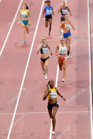 Stock Photo of Stephenie Ann McPherson of Jamaica leads her heat of the women's 4x400 meter relay during the World Athletics Championships in Doha, Qatar