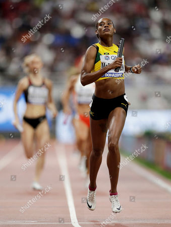 Stock Image of Jamaica's Stephenie Ann McPherson leads her team to win a women's 4x400 meter relay heat at the World Athletics Championships in Doha, Qatar