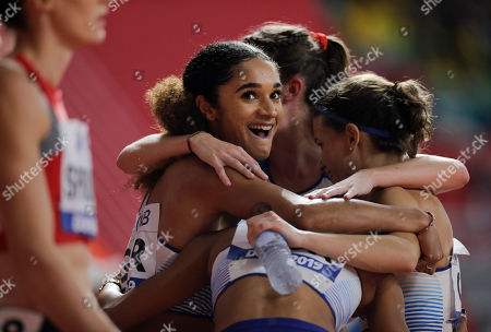 Britain's Jodie Williams smiles after finishing a women's 4x400 meter relay heat at the World Athletics Championships in Doha, Qatar