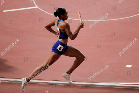 Allyson Felix of the United States races in a women's 4x400 meter relay heat at the World Athletics Championships in Doha, Qatar