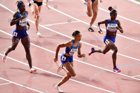 Allyson Felix, center, of the United States competes in her heat of the women's 4x400 meter relay during the World Athletics Championships in Doha, Qatar