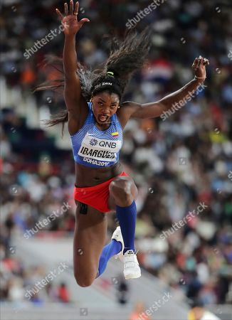 Caterine Ibarguen, of Colombia, competes in the women's triple jump final at the World Athletics Championships in Doha, Qatar