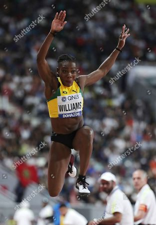 Kimberly Williams, of Jamaica, competes in the women's triple jump final at the World Athletics Championships in Doha, Qatar