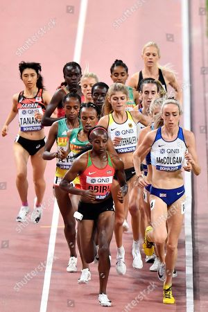 Eilish Mccolgan, of Great Britain, Konstanze Klosterhalfen, of Germany, and Hellen Obiri, of Kenya, from the right, compete in the women's 5000 meter final during the World Athletics Championships in Doha, Qatar