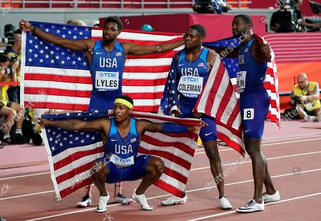 Gold medalists in the 4x100 relay from left, Noah Lyles, Michael Rodgers, Christian Coleman and Justin Gatlin celebrate at the World Athletics Championships in Doha, Qatar