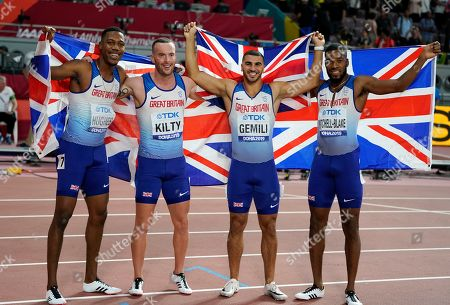 Silver medalists Zharnel Hughes, Richard Kilty, Adam Gemili and Nethaneel Mitchell-Blake, of Britain and N. Ireland, celebrate after the the men's 4x100 meter relay final at the World Athletics Championships in Doha, Qatar