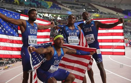 Gold medalists in the 4x100 relay from left, Noah Lyles, Michael Rodgers, Christian Coleman and Justin Gatlin, of the United States, celebrate at the World Athletics Championships in Doha, Qatar