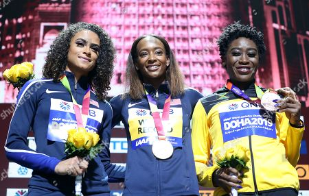 Gold medalist Dalilah Muhammad (C) of the USA, silver medalist Sydney McLaughlin (L) of the USA and bronze medalist Rushell Clayton of Jamaica during the medal ceremony for the women's 400m Hurdles at the IAAF World Athletics Championships 2019 at the Khalifa Stadium in Doha, Qatar, 05 October 2019.