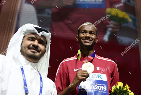 Qatari Sheikh Joaan bin Hamad bin Khalifa Al-Thani (foreground) stands in front of gold medalist Mutaz Essa Barshim of Qatar during the medal ceremony for the men's High Jump at the IAAF World Athletics Championships 2019 at the Khalifa Stadium in Doha, Qatar, 05 October 2019.