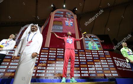 Qatari Sheikh Joaan bin Hamad bin Khalifa Al-Thani (foreground) stands in front of gold medalist Mutaz Essa Barshim (C) of Qatar, silver medalist Mikhail Akimenko (L) of Russia and bronze medalist Ilya Ivanyuk of Russia during the medal ceremony for the men's High Jump at the IAAF World Athletics Championships 2019 at the Khalifa Stadium in Doha, Qatar, 05 October 2019.