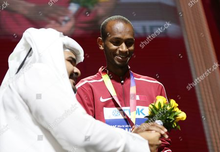 Qatari Sheikh Joaan bin Hamad bin Khalifa Al-Thani (L) hands flowers to gold medalist Mutaz Essa Barshim of Qatar during the medal ceremony for the men's High Jump at the IAAF World Athletics Championships 2019 at the Khalifa Stadium in Doha, Qatar, 05 October 2019.