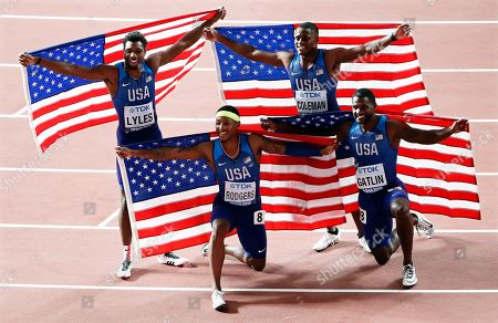 US relay team members (L-R) Noah Lyles, Michael Rodgers, Christian Coleman, and Justin Gatlin celebrate after winning the men's 4x100m Relay final at the IAAF World Athletics Championships 2019 at the Khalifa Stadium in Doha, Qatar, 05 October 2019.