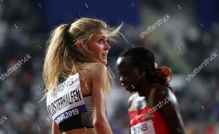 Konstanze Klosterhalfen (L) of Germany reacts after taking the third place in the women's 5,000m final at the IAAF World Athletics Championships 2019 at the Khalifa Stadium in Doha, Qatar, 05 October 2019.
