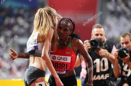 Hellen Obiri (R) of Kenya is congratulated by third placed Konstanze Klosterhalfen (L) of Germany after winning the women's 5,000m final at the IAAF World Athletics Championships 2019 at the Khalifa Stadium in Doha, Qatar, 05 October 2019.