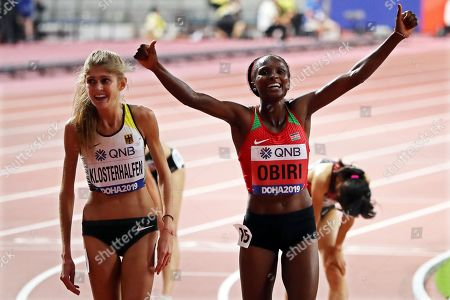 Hellen Obiri (R) of Kenya celebrates after winning the women's 5,000m final at the IAAF World Athletics Championships 2019 at the Khalifa Stadium in Doha, Qatar, 05 October 2019. Obiri won ahead of third placed Konstanze Klosterhalfen (L) of Germany.