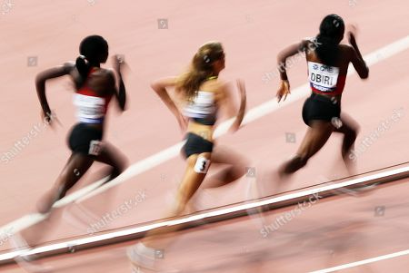 Hellen Obiri (R) of Kenya is on her way to win the women's 5,000m final at the IAAF World Athletics Championships 2019 at the Khalifa Stadium in Doha, Qatar, 05 October 2019. Obiri won ahead of her second placed compatriot Margaret Chelimo Kipkemoi (L) and third placed Konstanze Klosterhalfen (C) of Germany.