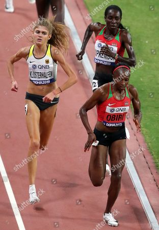 Hellen Obiri (front R) of Kenya is on her way to win the women's 5,000m final at the IAAF World Athletics Championships 2019 at the Khalifa Stadium in Doha, Qatar, 05 October 2019. Obiri won ahead of her second placed compatriot Margaret Chelimo Kipkemoi (back R) and third placed Konstanze Klosterhalfen (L) of Germany.
