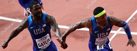 Justin Gatlin (L) of the USA hands over to his teammate Michael Rodgers (R) during the men's 4x100m Relay final at the IAAF World Athletics Championships 2019 at the Khalifa Stadium in Doha, Qatar, 05 October 2019. The US relay team won the race.
