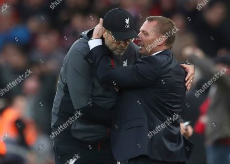 Leicester City's manager Brendan Rodgers, right, talks to Liverpool's manager Jurgen Klopp at the end of English Premier League soccer match between Liverpool and Leicester City in Anfield stadium in Liverpool, England