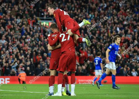 Liverpool players celebrate Liverpool's James Milner wining goal during English Premier League soccer match between Liverpool and Leicester City in Anfield stadium in Liverpool, England