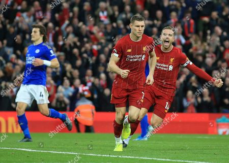Liverpool's James Milner celebrates his wining goal with Liverpool's Jordan Henderson during English Premier League soccer match between Liverpool and Leicester City in Anfield stadium in Liverpool, England
