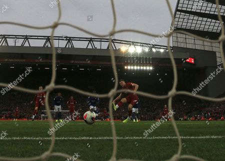 Liverpool's James Milner scores the wining goal past Leicester City's goalkeeper Kasper Schmeichel during English Premier League soccer match between Liverpool and Leicester City in Anfield stadium in Liverpool, England