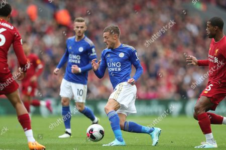 Leicester City's Jamie Vardy, centre, controls the ball past Liverpool's Georginio Wijnaldum and Liverpool's Trent Alexander-Arnold during the English Premier League soccer match between Liverpool and Leicester City in Anfield stadium in Liverpool, England