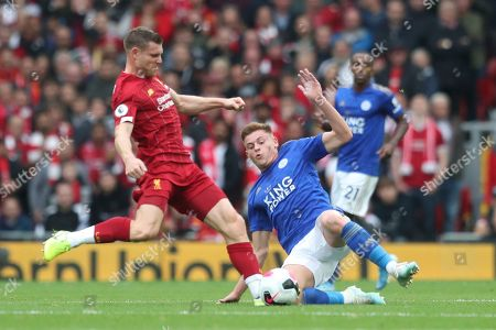 Leicester City's Harvey Barnes, right, vies for the ball with Liverpool's James Milner during English Premier League soccer match between Liverpool and Leicester City in Anfield stadium in Liverpool, England