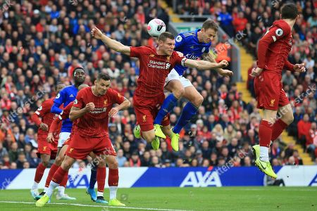 Liverpool's James Milner and Leicester City's Jonathan Evans vies for the ball during English Premier League soccer match between Liverpool and Leicester City in Anfield stadium in Liverpool, England