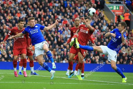 Leicester City's Jonathan Evans, Leicester City's Harvey Barnes and Liverpool's Dejan Lovren vies for the ball during English Premier League soccer match between Liverpool and Leicester City in Anfield stadium in Liverpool, England
