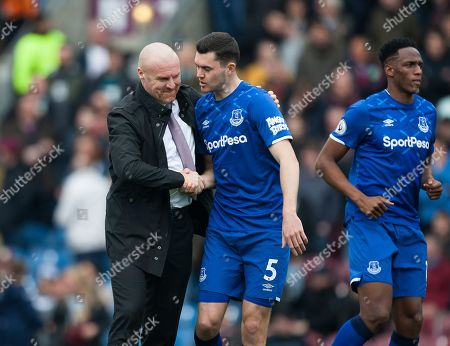 Burnley manager Sean Dyche (L) and Michael Keane of Everton before the match