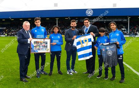Commercial and Marketing  Amit Bhatia QPR Chairman with Mumbai Challenger director and children on the pitch at half time