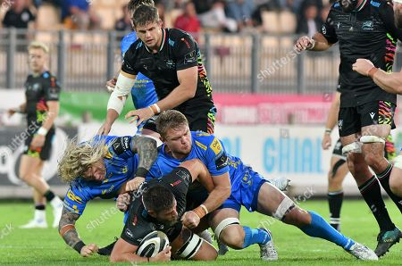 Zebre vs Dragons. Iacopo Bianchi of Zebre tackled by Richard Hibbard and Joe Davies of Dragons