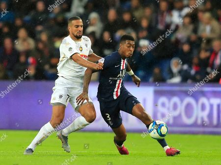 Angers' Rachid Alioui, left, PSG's Presnel Kimpembe battle for the ball during French League One soccer match between PSG and Angers at the Parc des Princes stadium in Paris